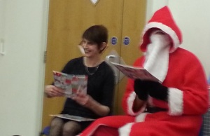 Liz helping Father Christmas distribute presents